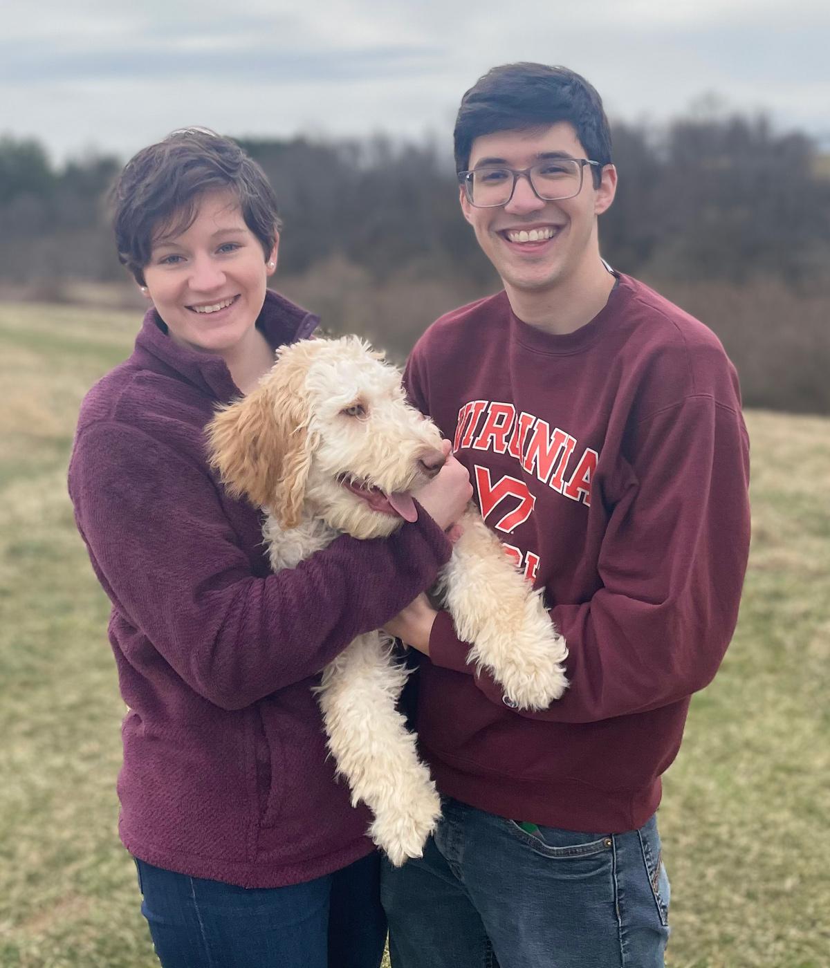 Ian and Catherine Jelliffe holding their dog Watson