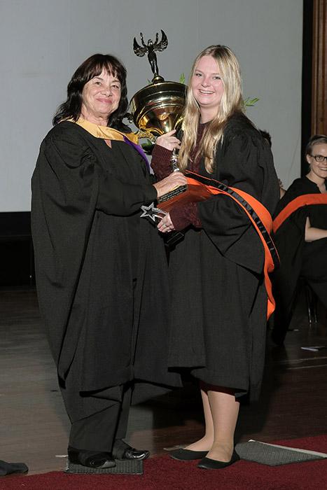 Dedicated Student Receiving Award