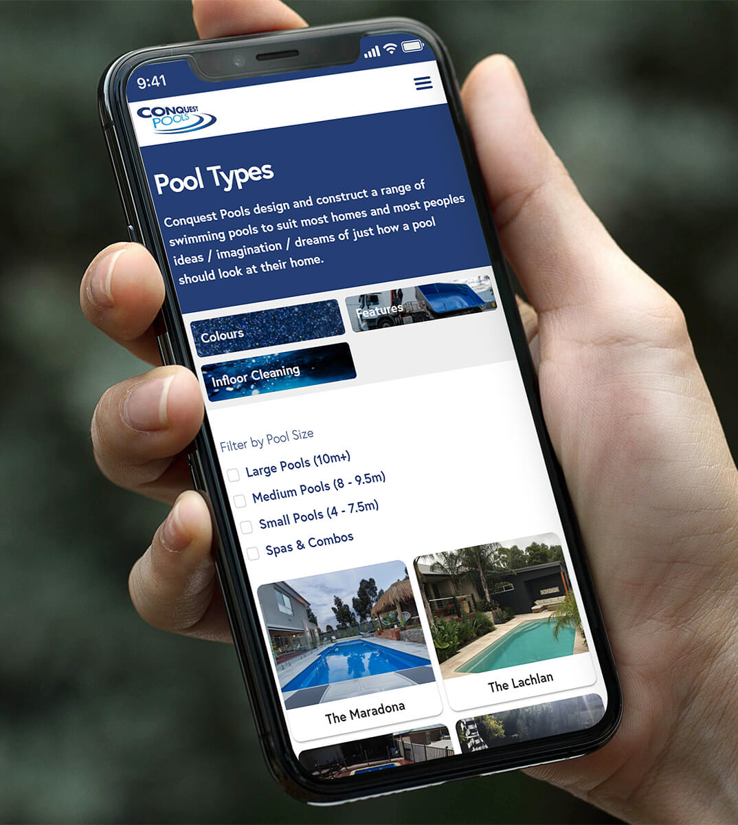 A hand holding a phone with the Conquest Pools website loaded