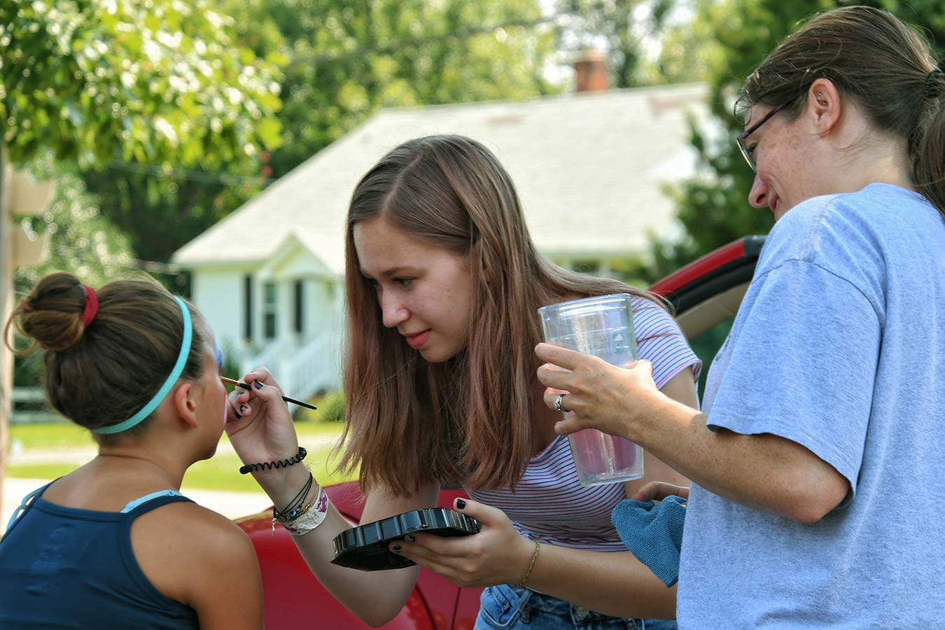 A Girl Facepainting At the 4th of July Tilghman Island Community Party