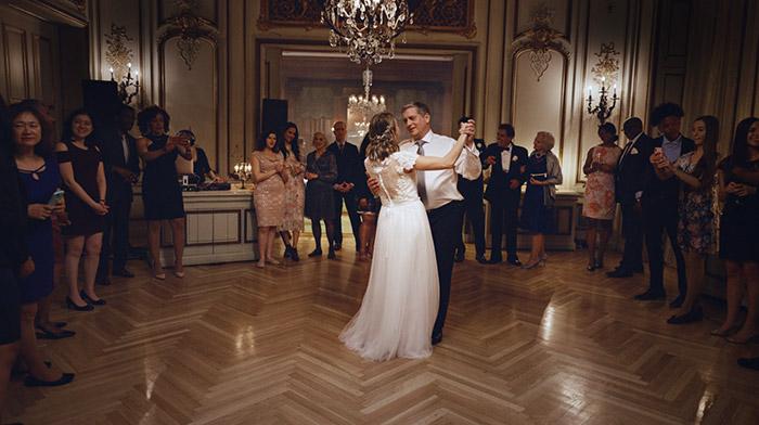 Mass Mutial commercial still of father and daughter dancing at daughter's wedding