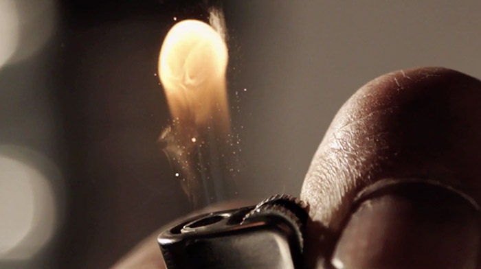 BGH commercial still of hand turning on lighter