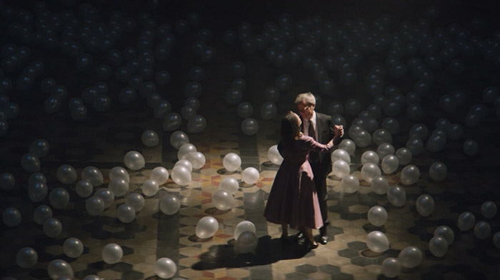 Movistar commercial still of older couple dancing in a ballroom full of white balloons