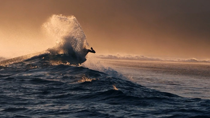 Quiksilver commercial still of surfer hitting the lip of a wave