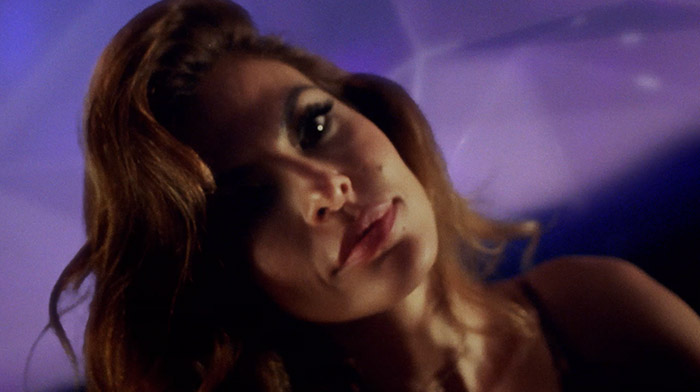 Avon commercial still of actress Eva Mendez looking into the camera