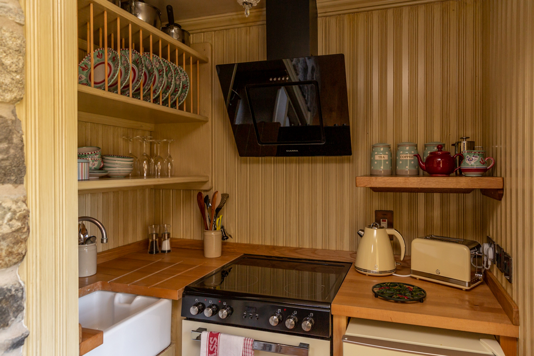 Kitchenette with Belfast sink and all the essentials for a self-catered stay.