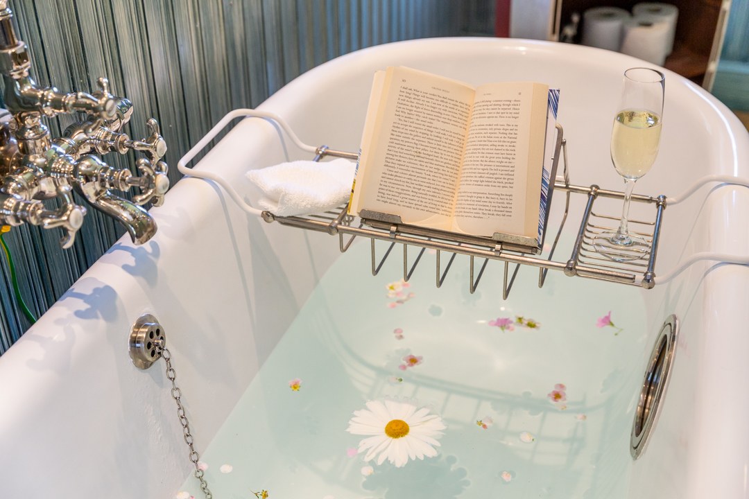 Enjoy a unique pothole bath with a good book and glass of bubbly