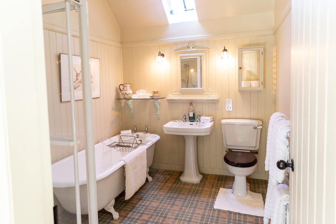 Family bathroom with roll top bath.