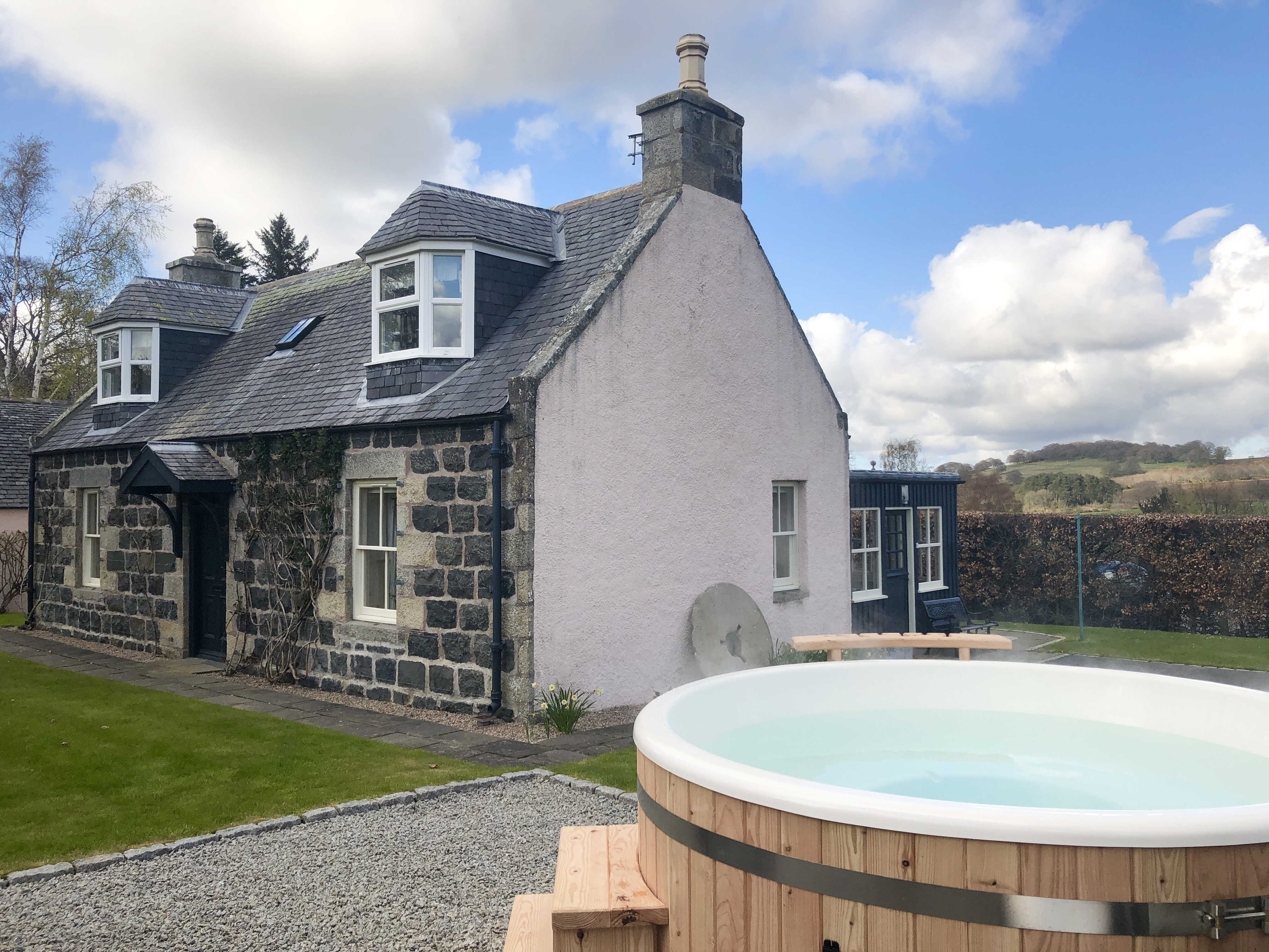 Bailies cottage private garden and chocolate box exterior with fire pit and seating.