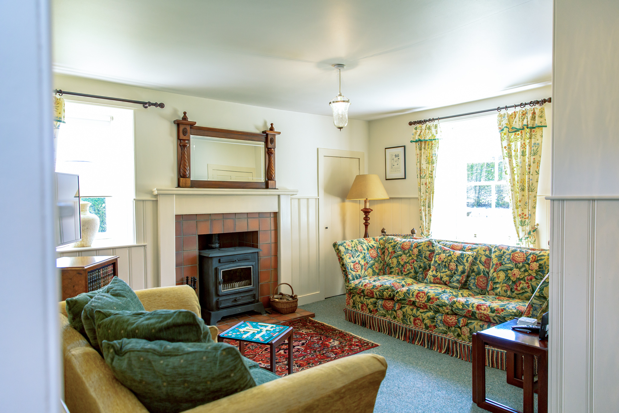 Comfortable living room with large wood burning stove.