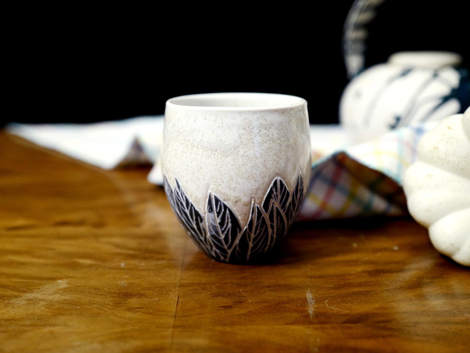 Gobelet à thé plumes