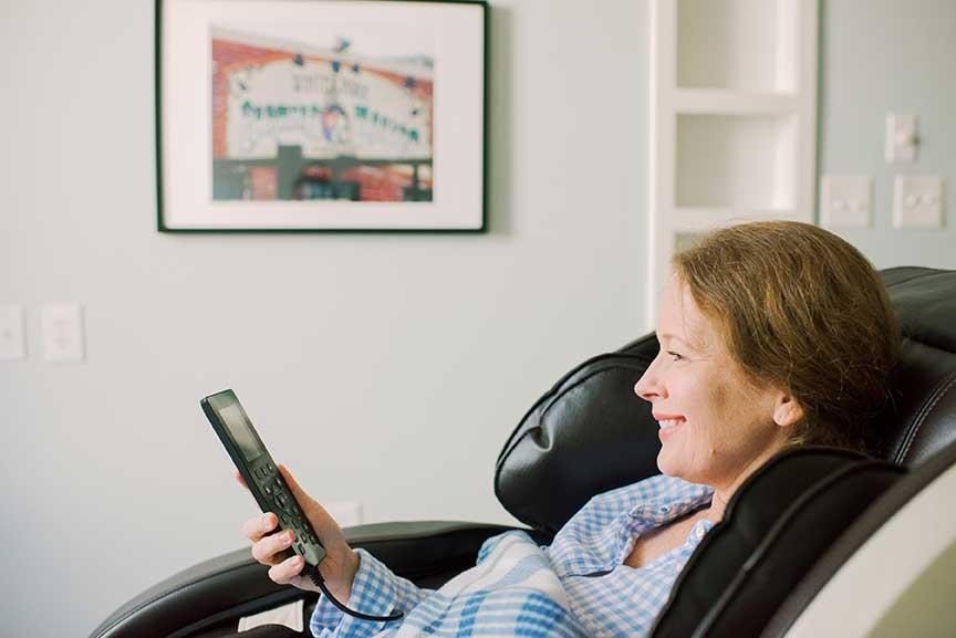 patient adjusting massage chair settings
