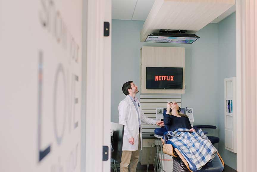 patient watching netflix in dentist chair