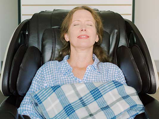 relaxed patient in massage chair