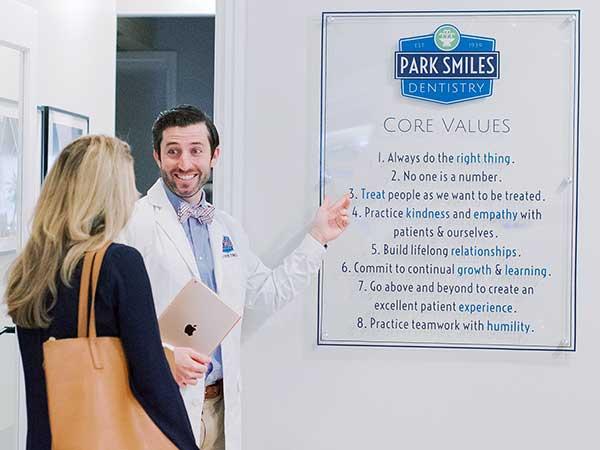 Dr. Drew Byrnes showing core values sign