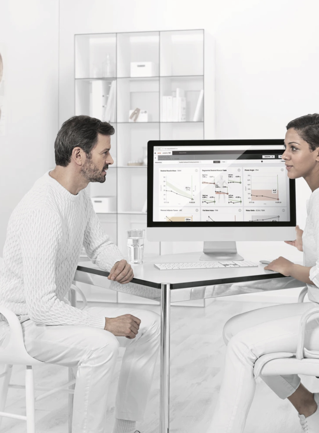 Doctor and patient discussion test result on the desktop screen
