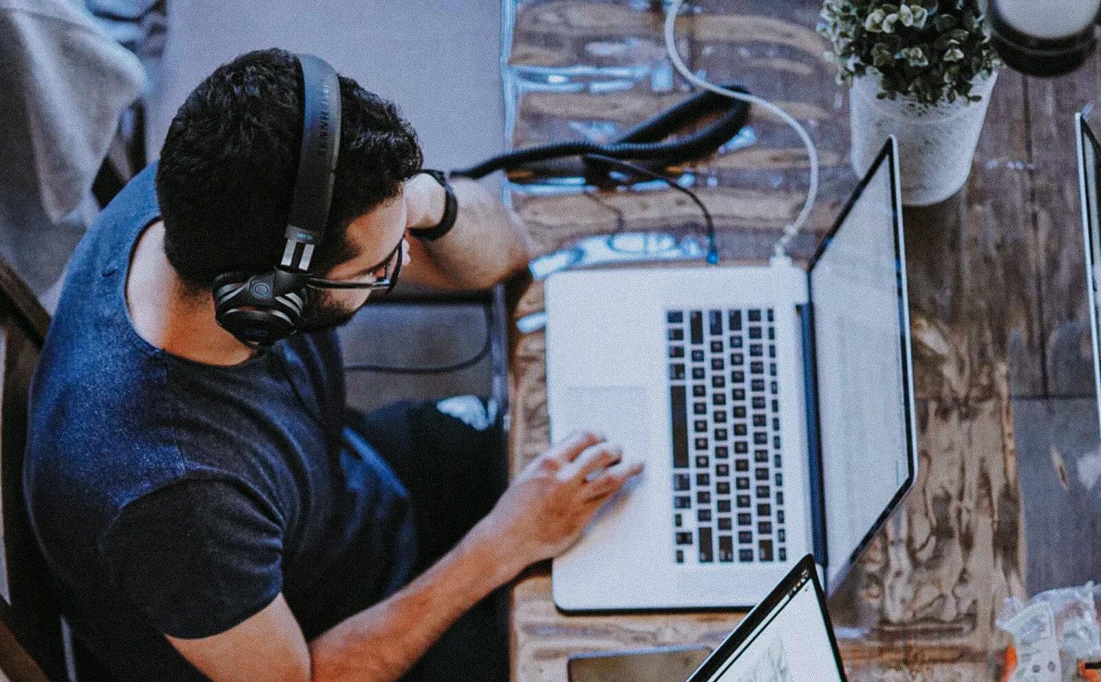 UX Designer working on his laptop
