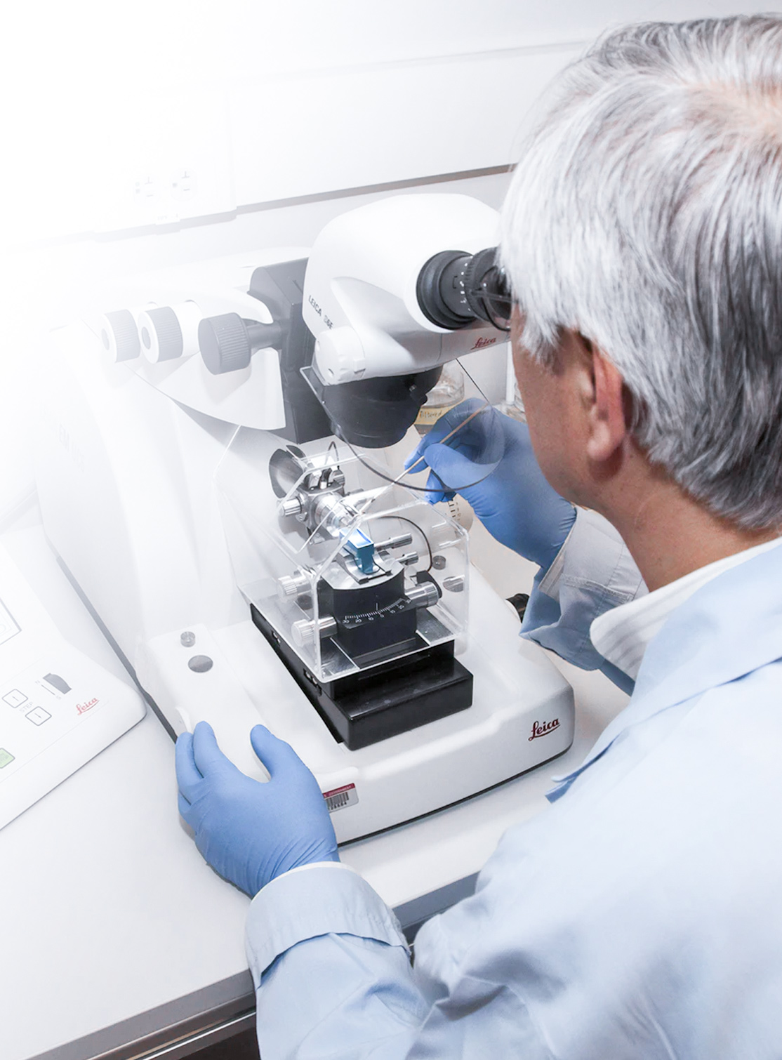 Scientist working on a microscope