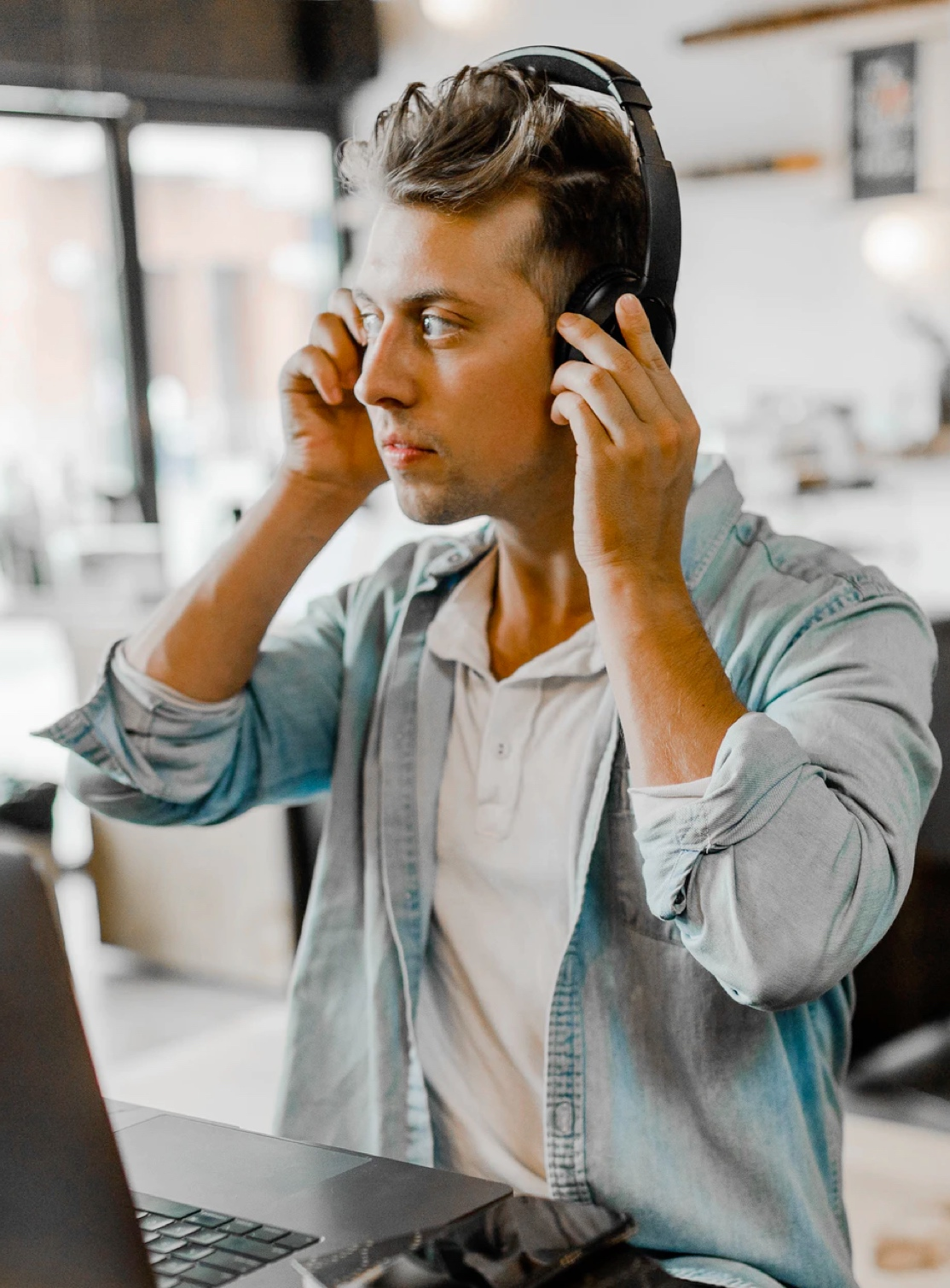 Sales manager with headphones on