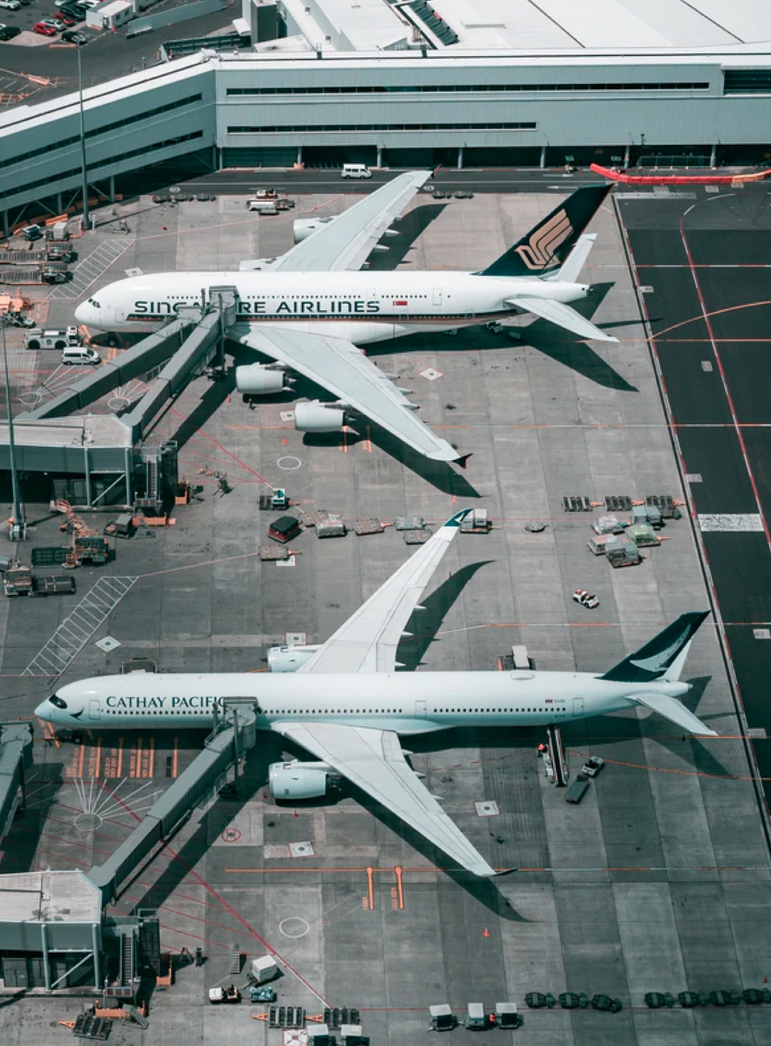 Big planes docked in an airport