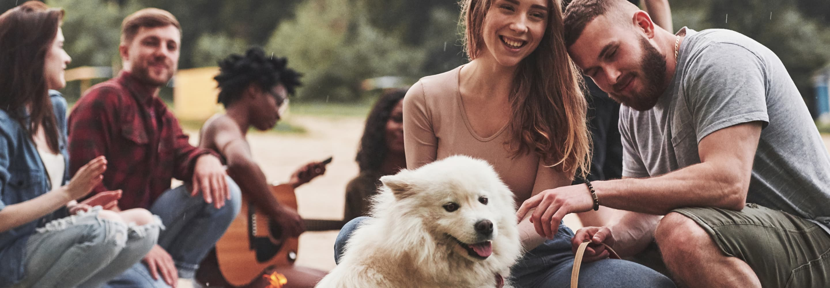 An image of people with their dog