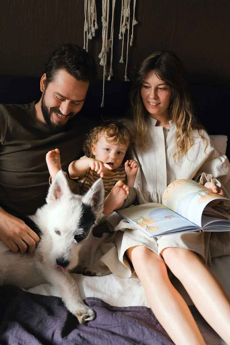An image of a family with a dog