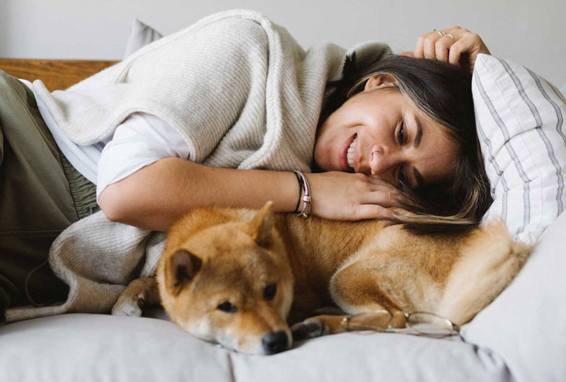 An image of a woman and her dog