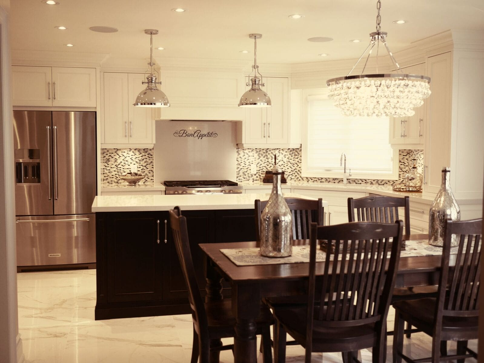 bright traditional kitchen with dark wood island