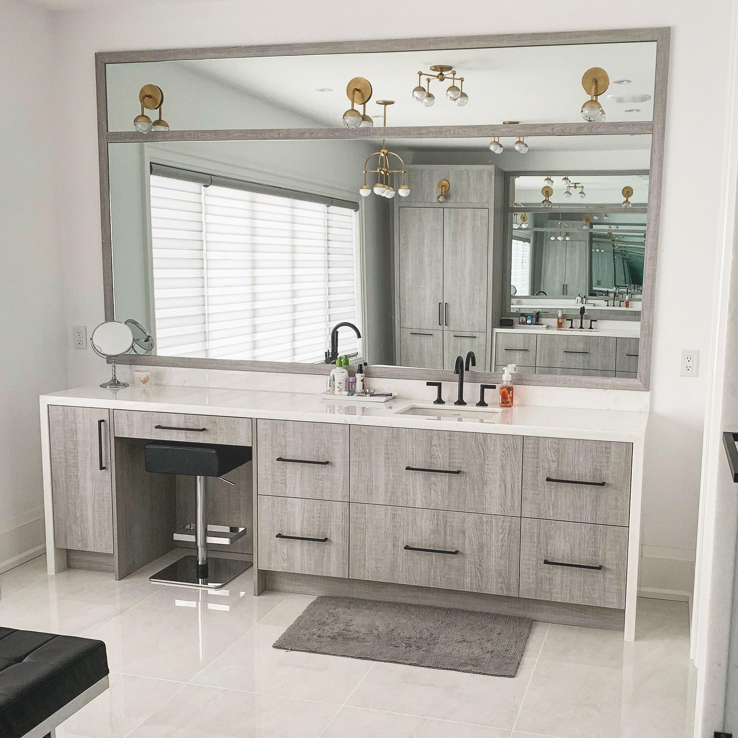 clean modern bathroom with large mirror