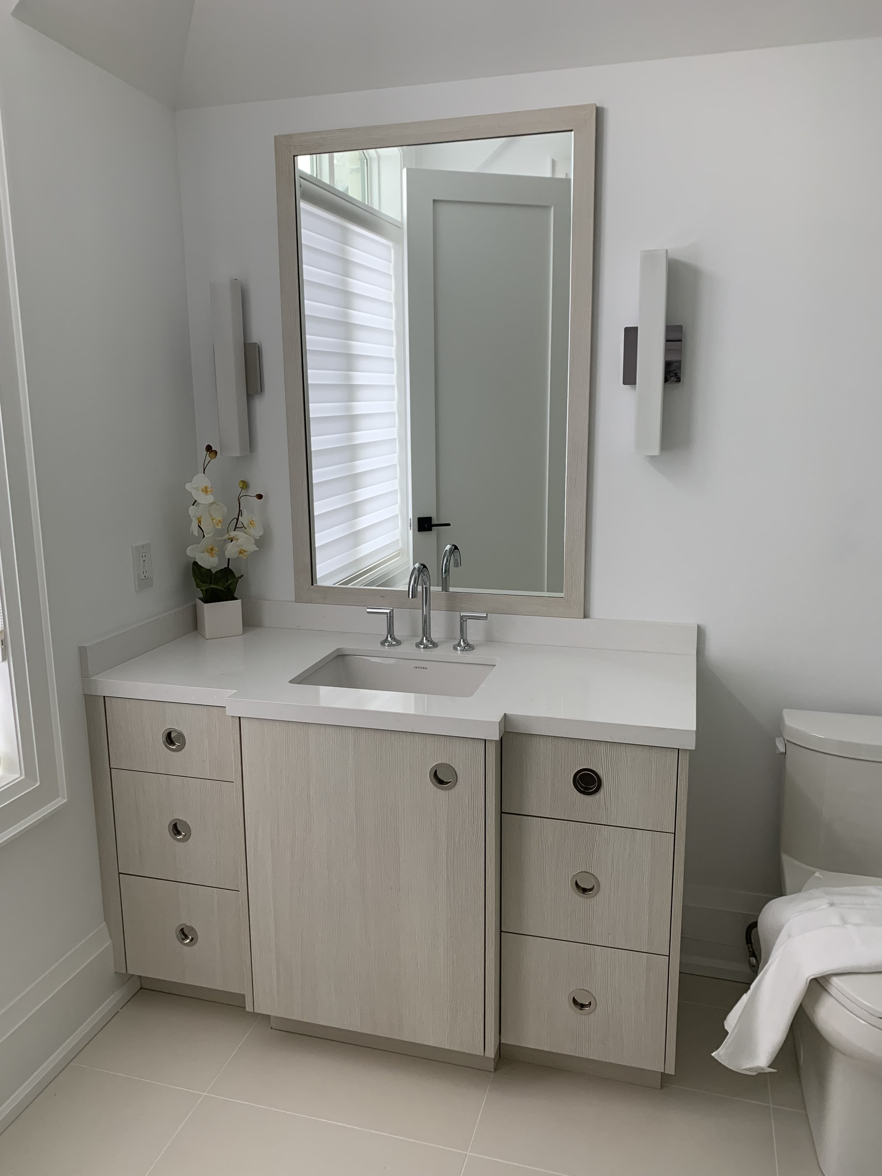 small grey vanity with recessed handles