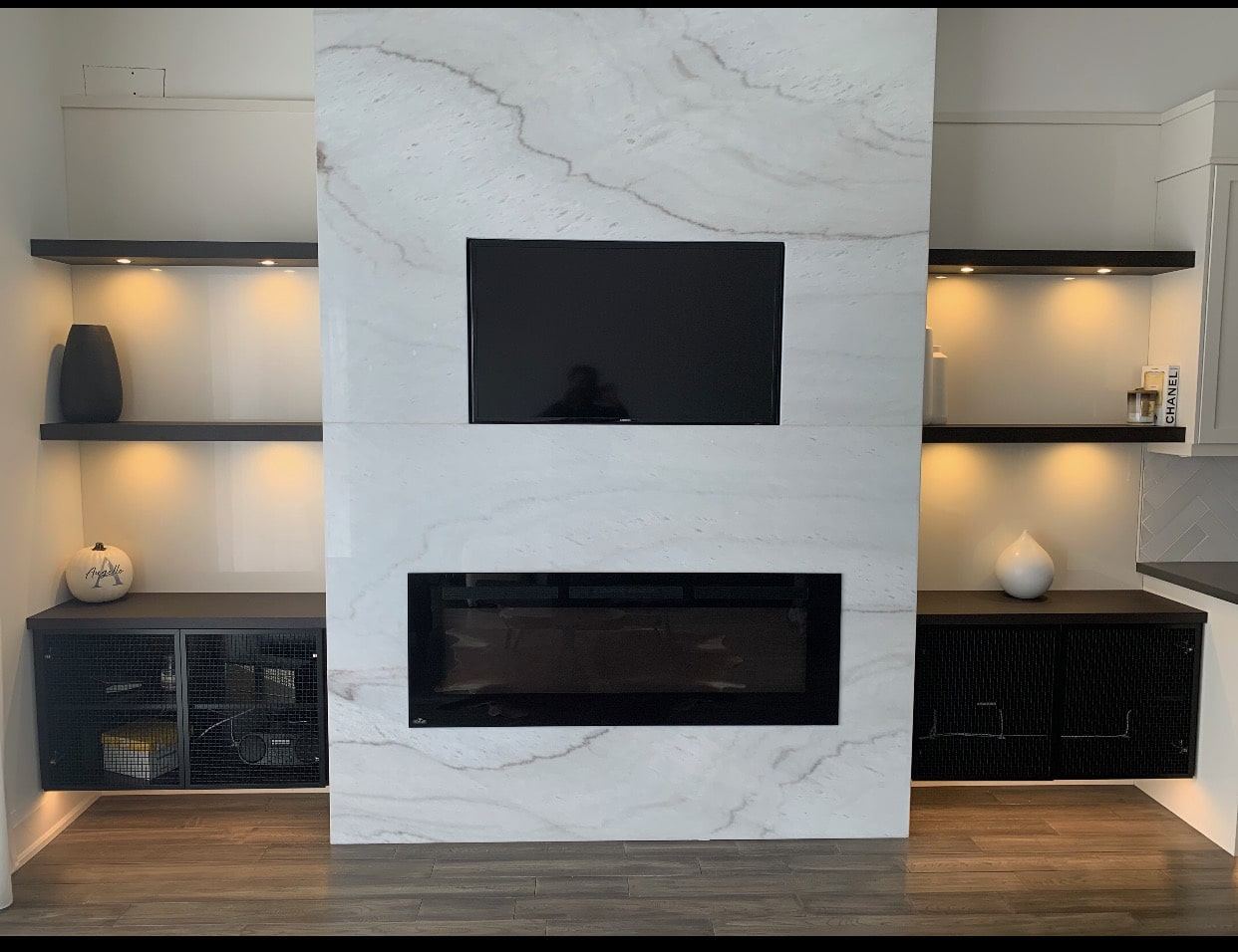 dark fireplace unit with marble front
