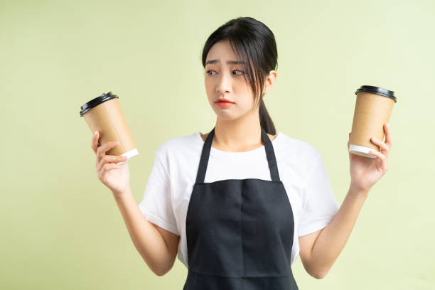 female line cook working in kitchen
