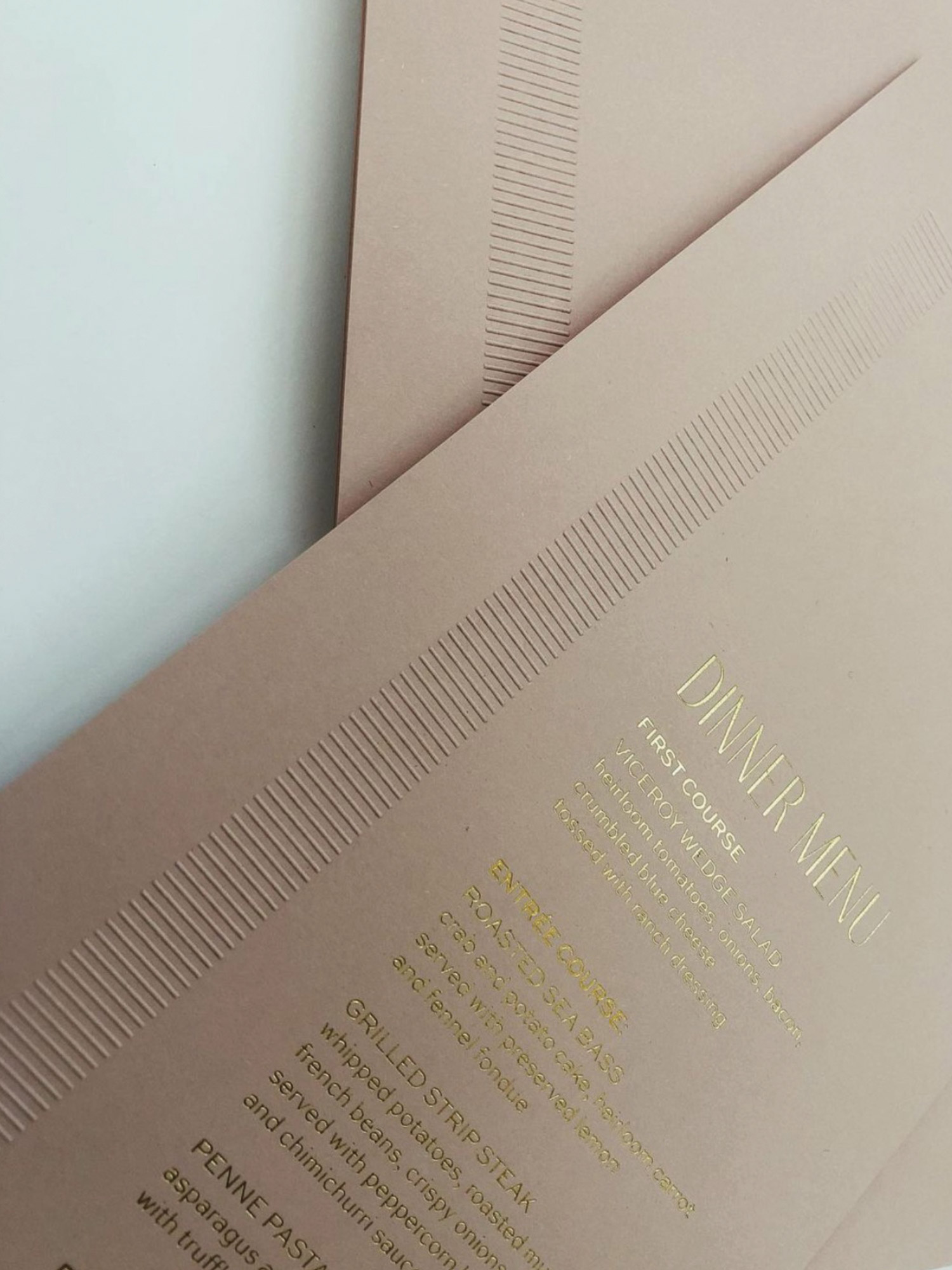 A custom emboss and foil stamped wedding invitation