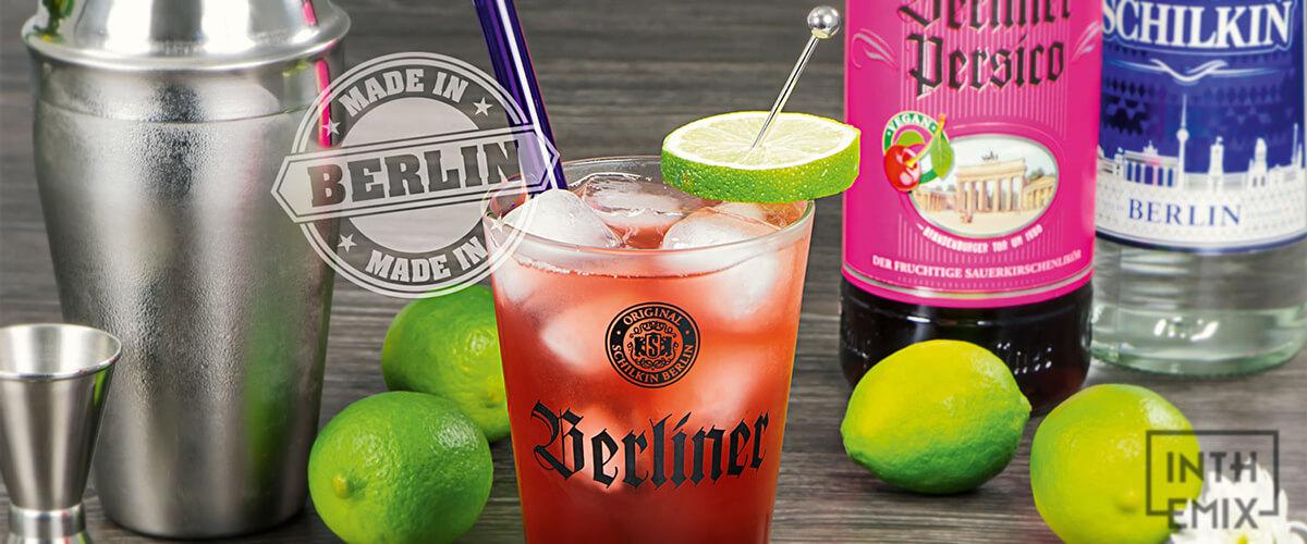In The Mix Moodbild mit Berliner Persico, Vodka SCHILKIN Flaschen und einem Cocktail