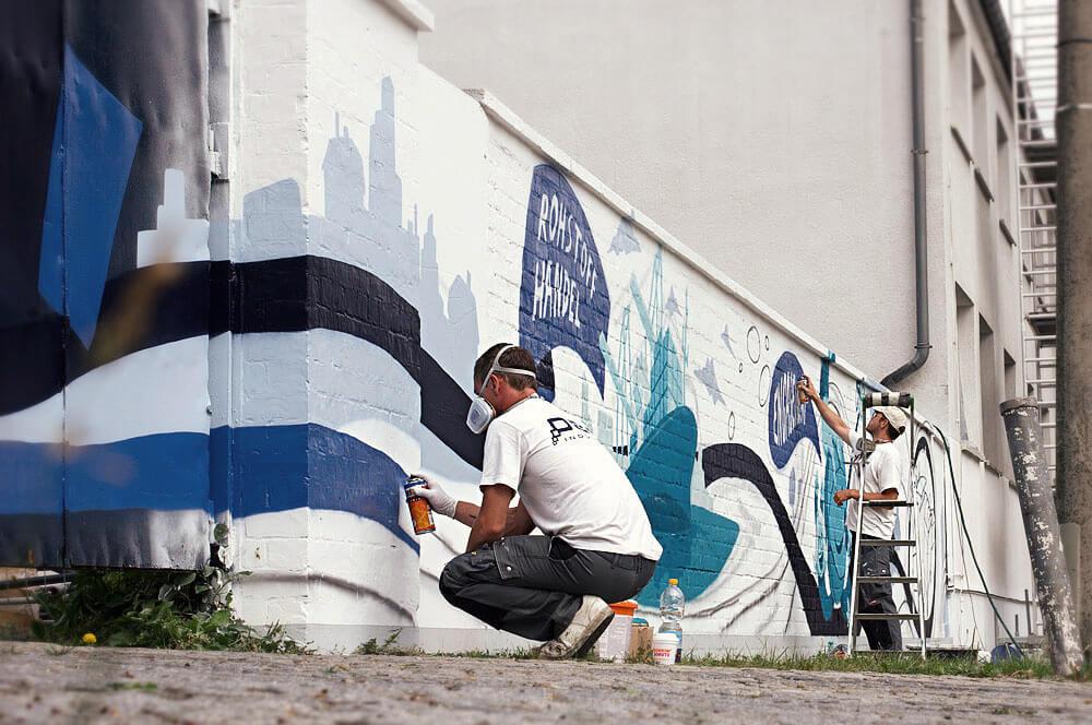 ALBAGROUP: Graffiti Artist bei der Arbeit