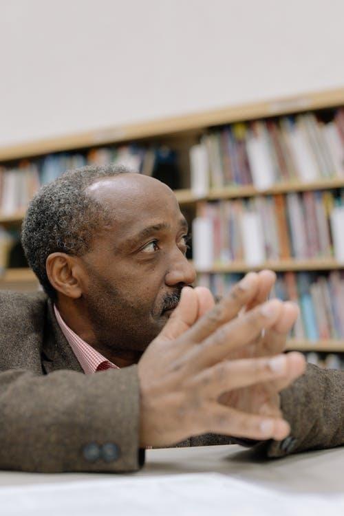 Photo Of Man Wearing Brown Coat