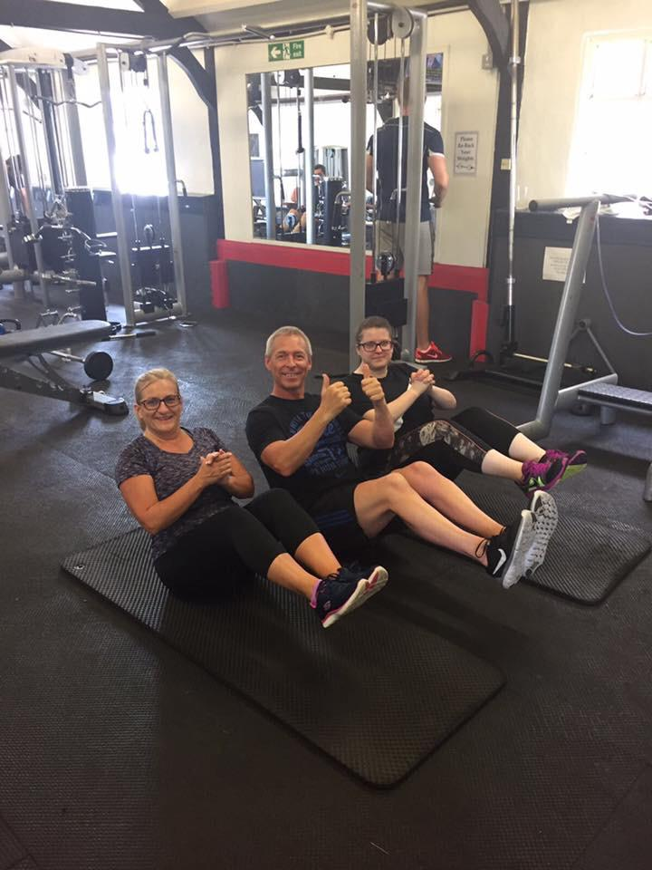 Infitness personal trainers with happy members