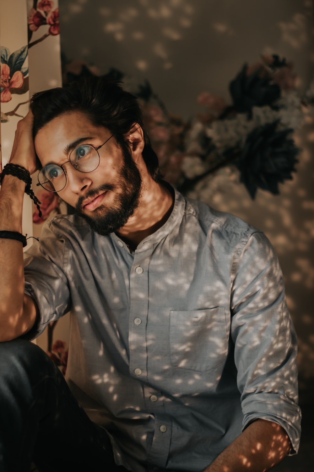 man in blue and white button up shirt wearing black framed eyeglasses