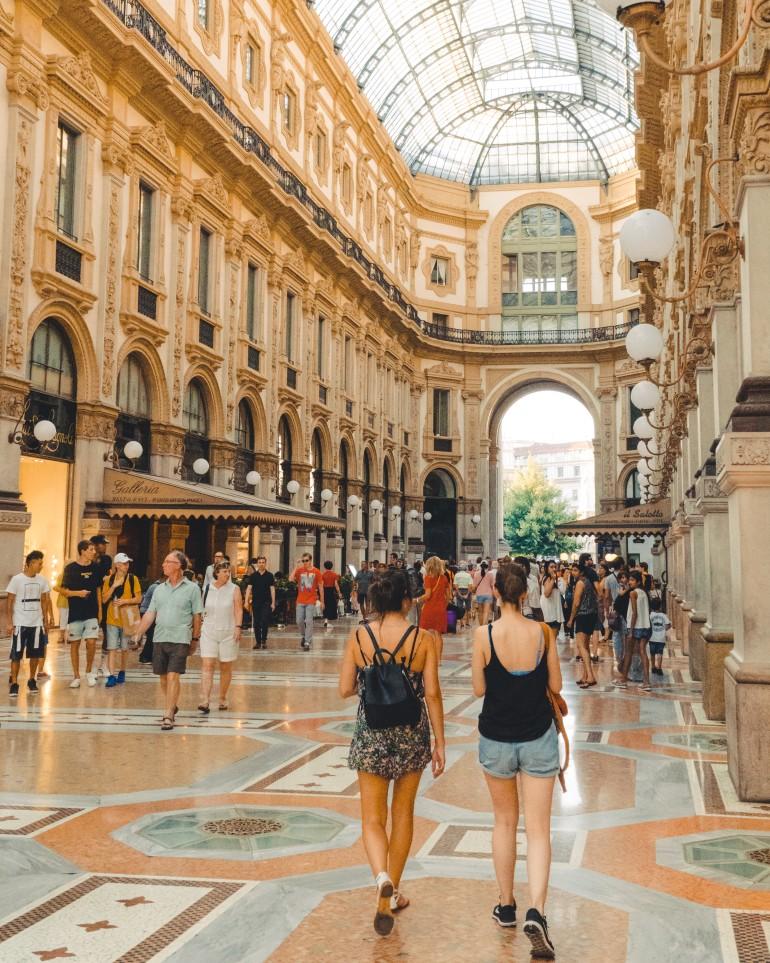 two-girls-walking-through-galleria-vittorio-emanuele-ii-shopping-in-milan-italy_t20_YVkxNW.jpg