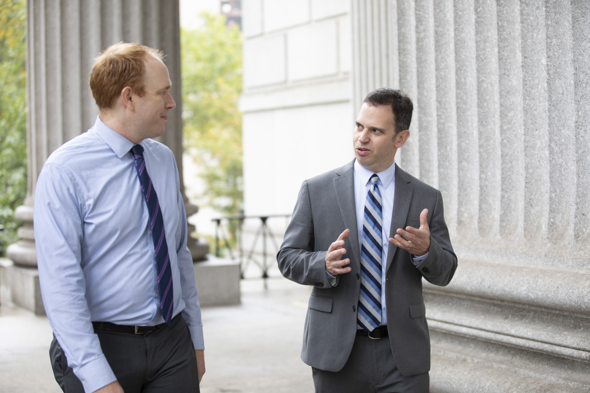 Dan Quart speaking with a lawyer at the courthouse