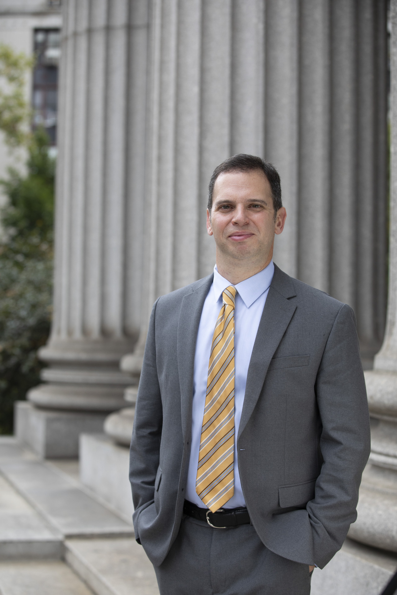 Dan Quart in a suit in front of the New York County Court House