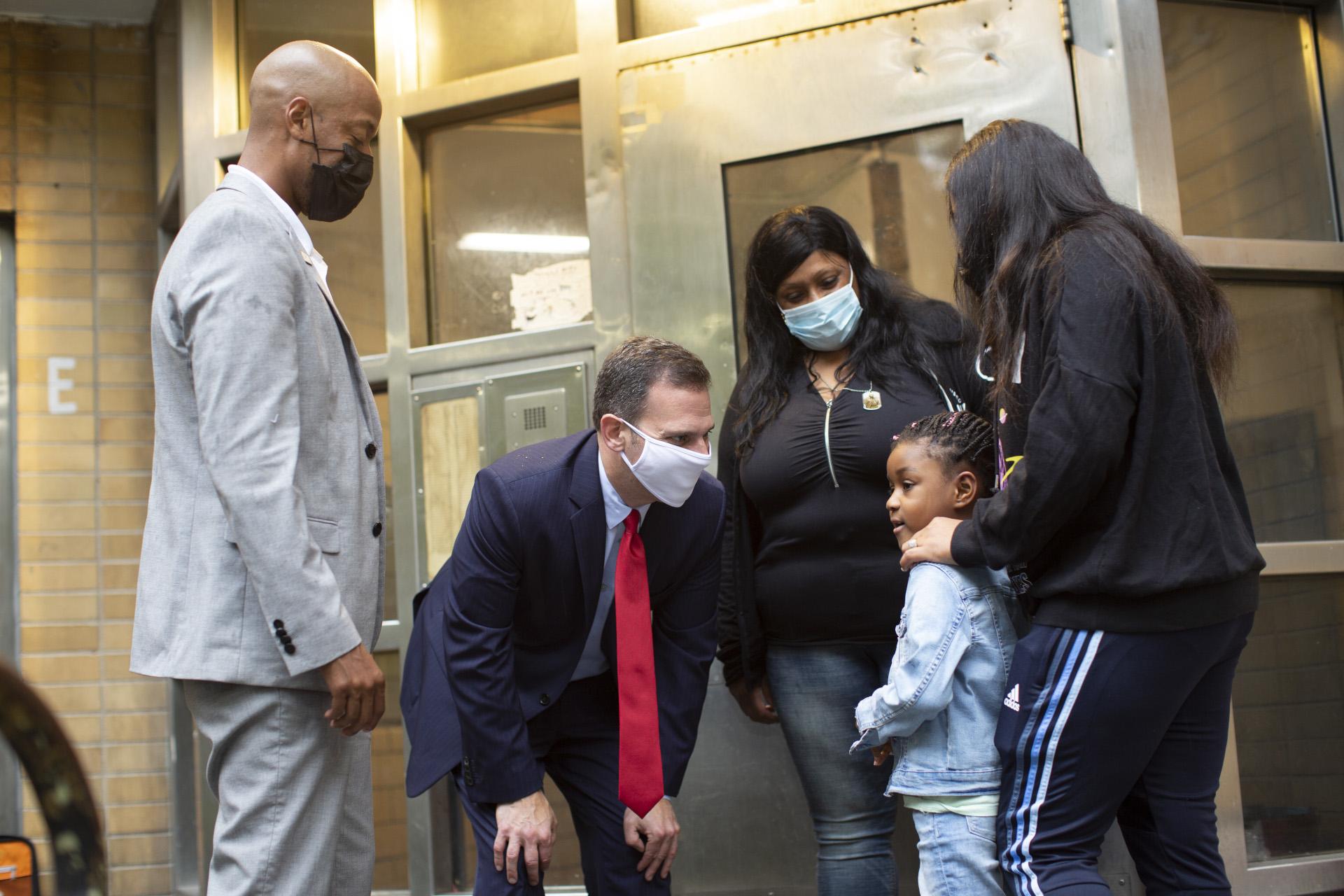 Dan Quart meeting a family in East Harlem