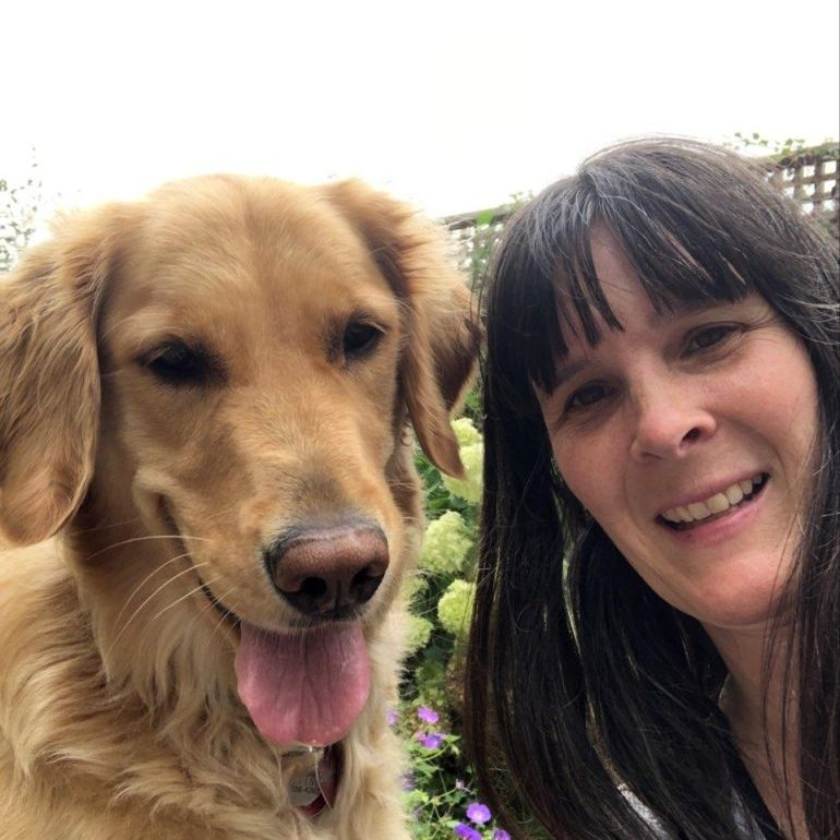 woman and golden retriever smiling