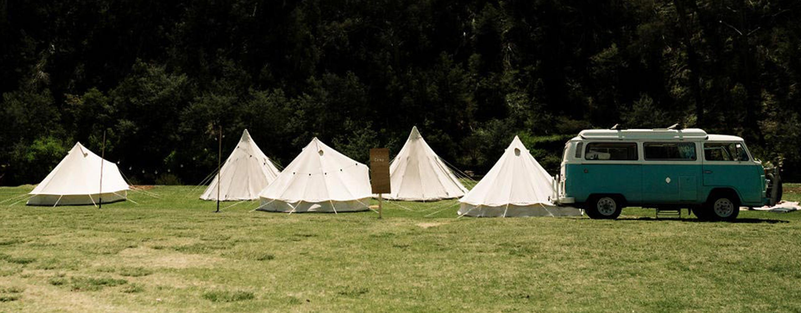 Glamping — group of bell tents and tipi tents pitched in Gippsland, Victoria