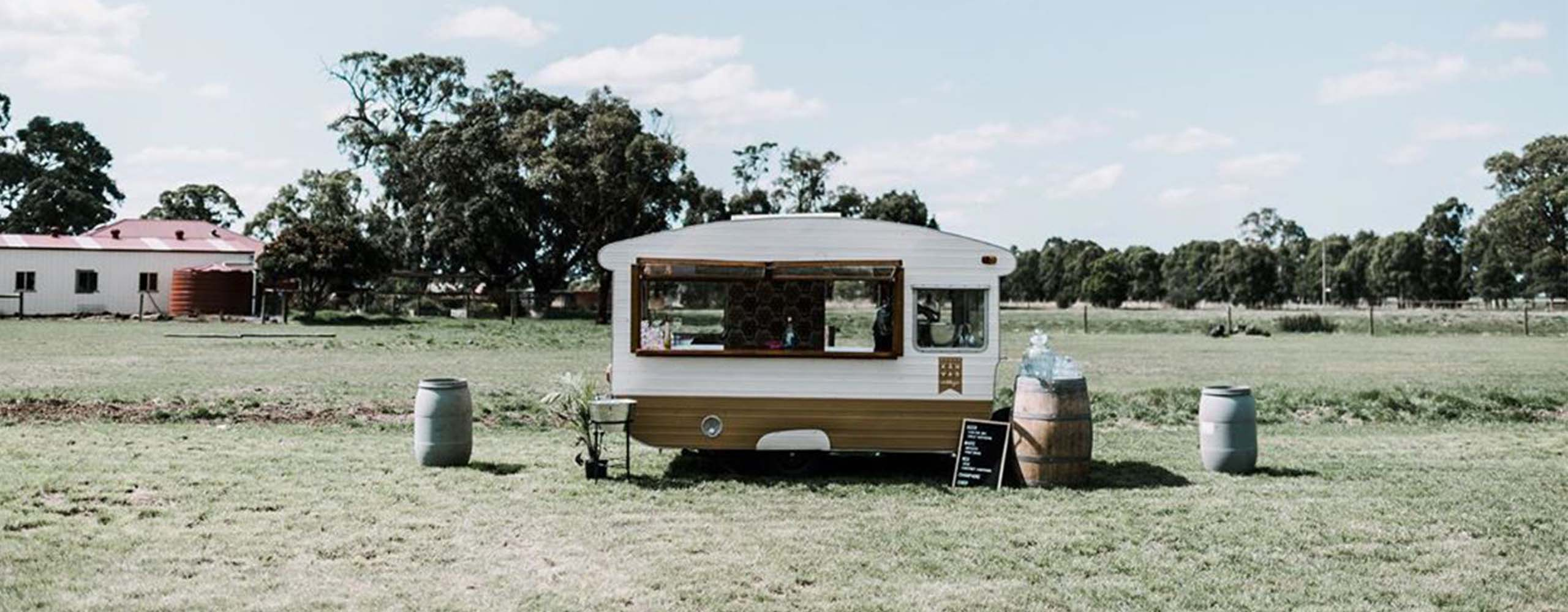 Caravan bar — wine barrels and floral styling at outdoor wedding in  regional Victoria