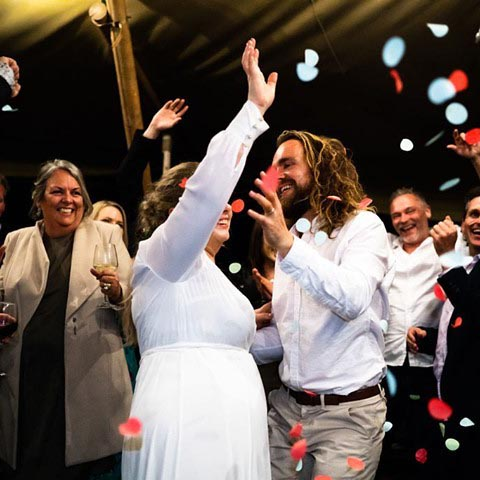 Instagram photo of tipi party with bride and groom covered in confetti
