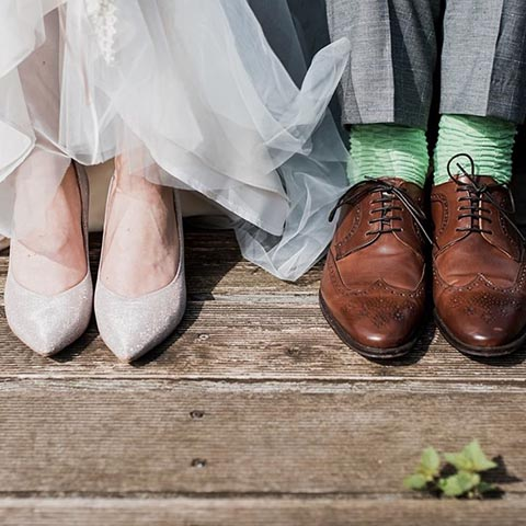 Instagram photo of bride and groom's shoes at wedding