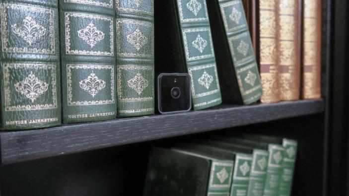 Smart Secret Battery Camera in a bookshelf