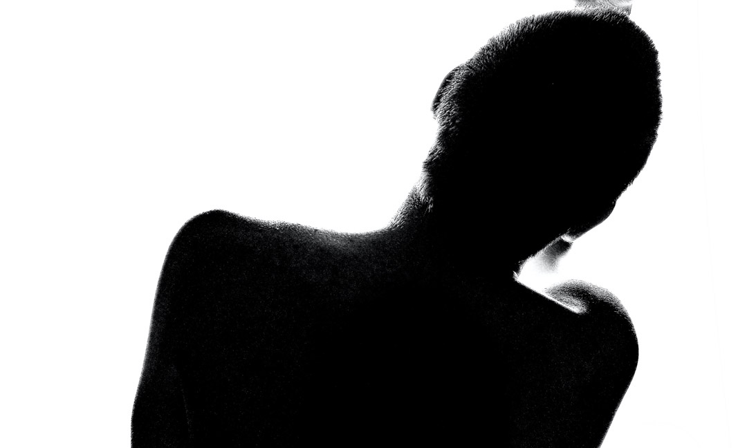 Black outline of a woman's back on a white background.