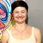 Smiling woman in front of colourful background image